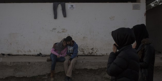 A young couple embraces outside a registration center for migrants and refugees in Moria village on the northeastern Greek island of Lesbos, Wednesday evening, Nov. 18, 2015. European leaders pressed ahead with efforts to discourage people from heading to Europe to find work and kept seeking ways to send back home thousands who don't qualify for asylum. (AP Photo/Santi Palacios)