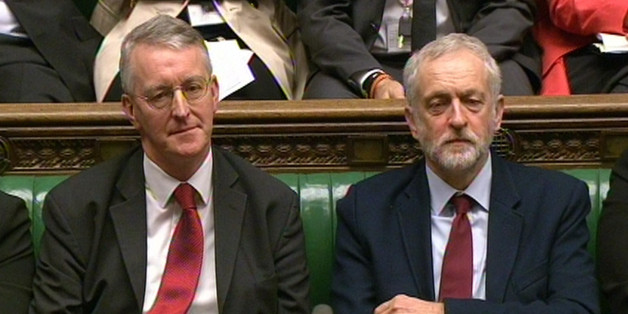 Shadow foreign secretary Hilary Benn (left) and Labour Party leader Jeremy Corbyn look on in the House of Commons yesterday
