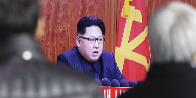 """South Koreans watch a TV news program showing North Korean leader Kim Jong Un's New Year speech, at the Seoul Railway Station in Seoul, South Korea, Friday, Jan. 1, 2016. Kim said in an annual New Year speech that he's ready for war if provoked by """"invasive"""" outsiders but stayed away from past threats centering on the country's nuclear weapons and long-range missile ambitions.(AP Photo/Ahn Young-joon)"""