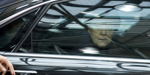 German Chancellor Angela Merkel looks out of her car window as she arrives for an EU summit at the EU Council building in Brussels on Thursday, Dec. 17, 2015. European Union heads of state meet Thursday to discuss, among other issues, the current migration crisis and terrorism. (AP Photo/Geert Vanden Wijngaert)