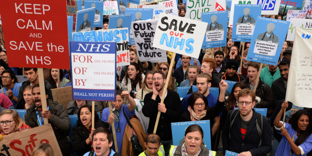 File photo dated 17/10/2015 of demonstrators listen to speeches in Waterloo Place during the 'Let's Save the NHS' rally and protest march by junior doctors in London.