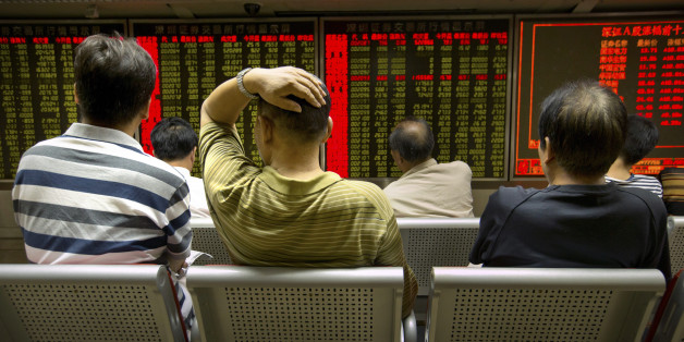 Chinese investors monitor stock prices at a brokerage house in Beijing, Tuesday, Aug. 18, 2015. The Shanghai Composite Index fell 6.2 percent on Tuesday as investors resumed sell-offs of Chinese stocks despite the stabilization of the Chinese yuan. (AP Photo/Mark Schiefelbein)