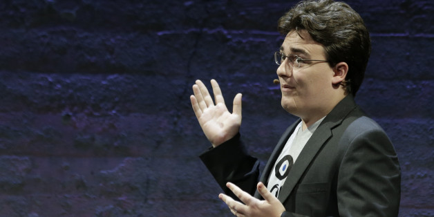 Oculus Founder Palmer Luckey talks about the Rift virtual-reality headset during a news conference Thursday, June 11, 2015, in San Francisco. Oculus is expanding its highly anticipated virtual-reality headset to simulate the sensation of touch and gesturing as part of its quest to blur the lines between the fake and genuine world. (AP Photo/Eric Risberg)