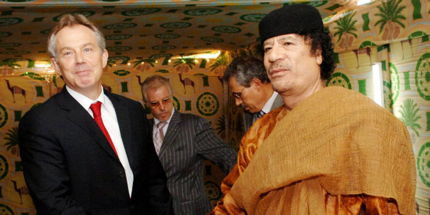 File photo dated 29/05/07 of Tony Blair (left) and Colonel Gaddafi shaking hands at Gaddafi's desert base near Sirte, Libya, as newly released correspondence shows that Mr Blair privately urged the Libyan dictator to stand aside as rebellion erupted against his regime.