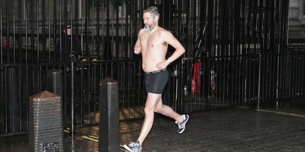 Daily Telegraph political journalist Dan Hodges streaks past Downing Street, London, after losing a bet for underestimating the Ukip's influence during last year's general election.