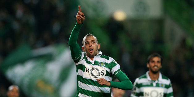 Sporting's Islam Slimani, celebrates after scoring the opening goal  during a Portuguese league soccer match against Porto at the Alvalade stadium in Lisbon, Saturday, Jan. 2 2016. (AP Photo/Steven Governo)