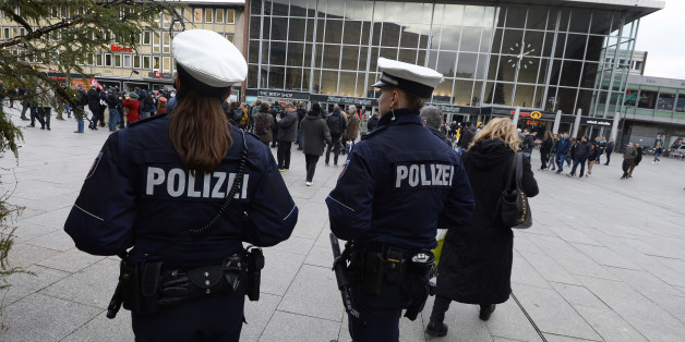 Police officers survey the area in front of the main train station and the Cathedral in Cologne, western Germany, on January 6, 2016, where dozens of apparently coordinated sexual assaults were perpetred against women on New Year's Eve.  / AFP / Roberto Pfeil        (Photo credit should read ROBERTO PFEIL/AFP/Getty Images)