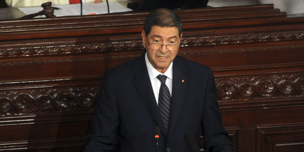 Tunisia's prime minister Habib Essid adresses the parliament in Tunis, Wednesday, July 8, 2015. ays that authorities believe plots aimed at massive deaths and destruction of the country's economy are in the works, and justify the state of emergency declared after a second deadly attack on tourists in three months. (AP Photo/Hassene Dridi)