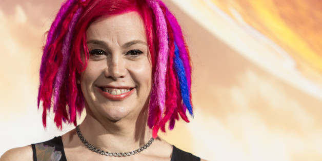 """FILE - In this Monday, Feb. 2, 2015 file photo, filmmaker Lana Wachowski attends the premiere of Warner Bros. Pictures' """"Jupiter Ascending"""" at TCL Chinese Theatre in Hollywood, Calif. When the filmmaker siblings are asked what incites the biggest spats between the brother-sister duo best known for writing and directing """"The Matrix"""" trilogy, Andy and Lana Wachowski provide a non-verbal response: They sweetly clasp each other's hands and tap their contrasting noggins - Lana's fuchsia-hued dreadloc"""