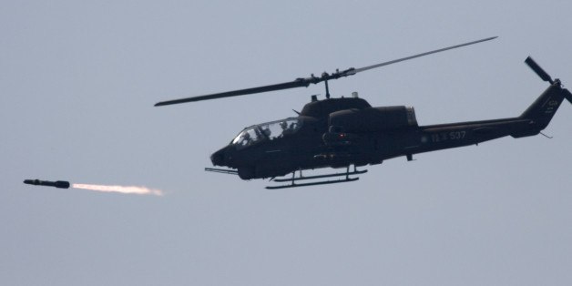 A U.S. made AH-1W attack helicopter launches a Hellfire missile during the annual Han Kuang No. 22 exercises, Thursday, July 20, 2006, in  Ilan, 80 kilometers (49 miles) west of Taipei, Taiwan. The goal of the exercises is to test the joint combat capability of the Taiwanese armed forces to fend off a Chinese offensive. Taiwan split from China in 1949 amid civil war and China hasn't ruled out the use of force to unify the island. (AP Photo)