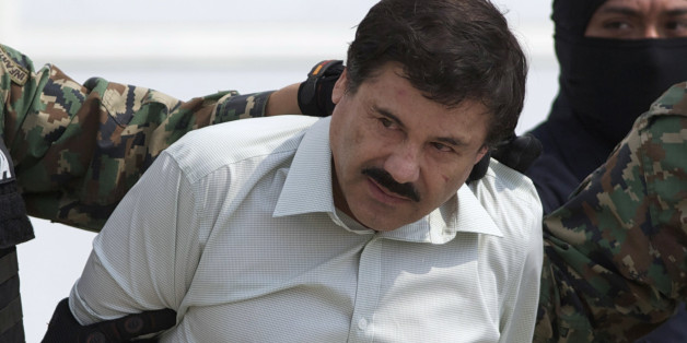 "FILE - This Feb. 22, 2014 file photo shows Joaquin ""El Chapo"" Guzman, the head of Mexico's Sinaloa Cartel, being escorted to a helicopter in Mexico City following his capture overnight in the beach resort town of Mazatlan. A judge in Mexico has issued a second arrest warrant to detain escaped drug lord Joaquin ""El Chapo"" Guzman based on an extradition request from the United States. The federal prosecutors' office said Wednesday, Sept. 23, 2015 the new warrant is for U.S. charges of or"