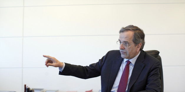 Antonis Samaras, former Greek prime minister and leader of the New Democracy party, gestures whilst speaking during an interview at his party headquarters in Athens, Greece, on Wednesday, April 1, 2015. Europe's most-indebted state is locked in negotiations with euro-area countries and the International Monetary Fund over the terms of its 240 billion-euro ($260 billion) rescue. Photographer: Kostas Tsironis/Bloomberg via Getty Images