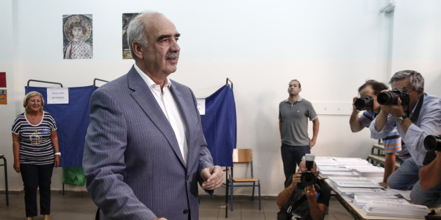 Evangelos Meimarakis, leader of the New Democracy Party of Greece, reacts as he places his voting slip in a ballot box as he votes in the general election in the suburb of Marousi, Athens, Greece, on Sunday, Sept. 20, 2015. Greeks began voting Sunday in a general election to determine who will lead efforts to implement European bailout agreements and restore economic normalcy to the continents most indebted country. Photographer: Yorgos Karahalis/Bloomberg via Getty Images