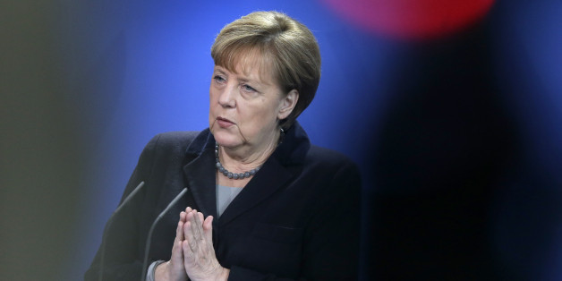 German Chancellor Angela Merkel gestures during a joint news conference with the Prime Minister of Romania, Dacian Ciolos, as part of a meeting at the chancellery in Berlin, Germany, Thursday, Jan. 7, 2016. (AP Photo/Michael Sohn)