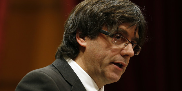 "Incoming Catalan President Carles Puigdemont speaks during the investiture session at the Catalonian parliament in Barcelona, Spain, Sunday, Jan. 10, 2016. Catalonia's pro-independence parties have agreed to appoint a new leader to enable the creation of a regional coalition government and reinvigorate a push for independence from Spain by 2017. Carles Puigdemont was selected Saturday to replace Artur Mas as the ""Together for Yes"" alliance's candidate for regional government leader. (AP Photo/Ma"