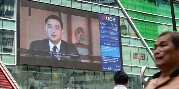 A big screen displays information on the stock index at the Raffles Place financial district in Singapore on January 11, 2016. Asian shares tumbled again on January 11 as another round of tepid data added to concerns about China's economy, which is already responsible for sparking a rout across global markets at the start of the year.       AFP PHOTO / ROSLAN RAHMAN / AFP / ROSLAN RAHMAN        (Photo credit should read ROSLAN RAHMAN/AFP/Getty Images)