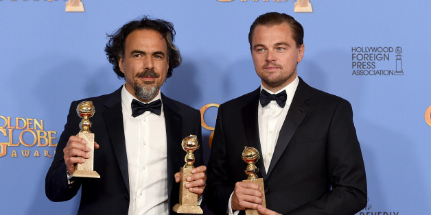 """Alejandro Gonzalez Inarritu, left, and Leonardo DiCaprio pose in the press room with the award for best motion picture - drama for """"The Revenant"""" at the 73rd annual Golden Globe Awards on Sunday, Jan. 10, 2016, at the Beverly Hilton Hotel in Beverly Hills, Calif. (Photo by Jordan Strauss/Invision/AP)"""