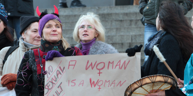 Participants of a women's  flash mob  demonstrate against racism and sexism    in Cologne, Germany, Saturday, Jan. 9, 2016.  Women's rights activists, far-right demonstrators and left-wing counter-protesters all took to the streets of Cologne on Saturday in the aftermath of a string of New Year's Eve sexual assaults and robberies in Cologne blamed largely on foreigners.  (AP Photo/Juergen Schwarz)