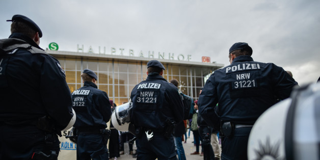 COLOGNE, GERMANY - JANUARY 06:  Police stand guard as supporters of Pro NRW, a right-wing, populist group that has campaigned against the construction of new mosques in the German state of North Rhine-Westphalia, protest following the New Year's Eve sex attacks by what witnesses described were gangs of Arab or North African men on January 6, 2015 in Cologne, Germany. So far 90 women have filed charges with police, claiming that they were brutally groped, some were robbed and one even raped by gangs of drunken Arab or North African men at Cologne's Hauptbahnhof main railway station on New Year's Eve. The incident has caused an uproar in Germany and police reported today they have made three arrests. Right-wing groups have responded with furore over the attacks, claiming they are a result of Germany's open-door refugee policy. Police however claim they have no evidence yet to show the attackers were refugees.  (Photo by Sascha Schuermann/Getty Images)