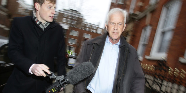 Environment Agency chairman Sir Philip Dilley leaves his flat in Marylebone, London, after arriving back in the country following a sunshine holiday in the Caribbean.