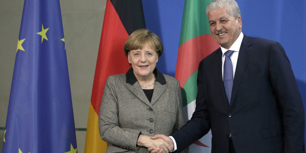 German Chancellor Angela Merkel, left, and the Prime Minister of Algeria Abdelmalek Sellal, right, shake hands after a joint press conference as part of a meeting at the chancellery in Berlin, Germany, Tuesday, Jan. 12, 2016. (AP Photo/Michael Sohn)