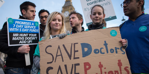Junior doctors and medical students demonstrate outside the Houses of Parliament in London as part of a nationwide one day strike in a dispute with the government over new contracts.