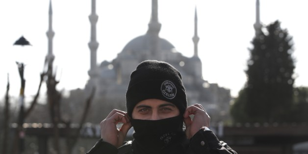 Backdropped by the Sultan Ahmed Mosque, better known as the Blue Mosque in the historic Sultanahmet district of Istanbul, a police officer secures the area after an explosion, Tuesday, Jan. 12, 2016  The explosion killed several people and wounded 15 others Tuesday morning in a historic district of Istanbul popular with tourists. Turkish President Recep Tayyip Erdogan said a Syria-linked suicide bomber is believed to be behind the attack. (AP Photo/Lefteris Pitarakis)