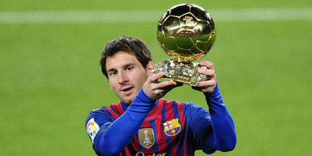FC Barcelona's Lionel Messi, from Argentina, holds his Ballon d'Or (Golden Ball) award as European Footballer of the Year before a Spanish La Liga soccer match between FC Barcelona and Betis at the Camp Nou stadium in Barcelona, Spain, Sunday, Jan. 15, 2012. (AP Photo/Manu Fernandez)
