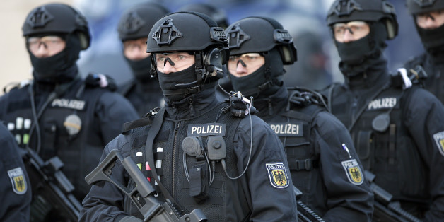 Police officers hold weapons during a training operation of the new BFE+ (Evidence and Arrestment) unit of the German federal police in Ahrensfelde near Berlin, Germany, Wednesday, Dec. 16, 2015. Germany on Wednesday introduced a new police unit that officials said will be better armed, outfitted and trained to deal with terrorism, based on an analysis of the countrys security in the wake of deadly attacks in Paris earlier this year. (AP Photo/Michael Sohn)
