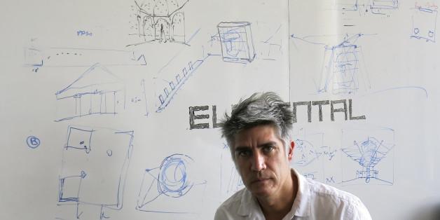 Chilean architect Alejandro Aravena poses for a photo at his studio in Santiago, Chile, Tuesday, Jan. 12, 2016. Aravena has been named the 2016 recipient of the Pritzker Prize. (AP Photo/Eva Vergara)
