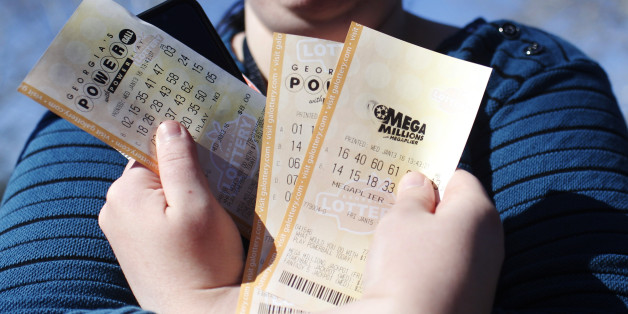 """Stephanie Barnett, of Center Point, Ala., holds up Powerball lottery tickets at Georgia Visitor Information Center, Wednesday, Jan. 13, 2016, in Tallapoosa, Ga. """"If I win, I want to build a new house,"""" says Barnett. (AP Photo/Brynn Anderson)"""
