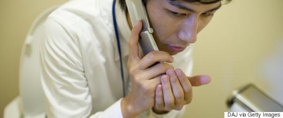 secretly using phone at work