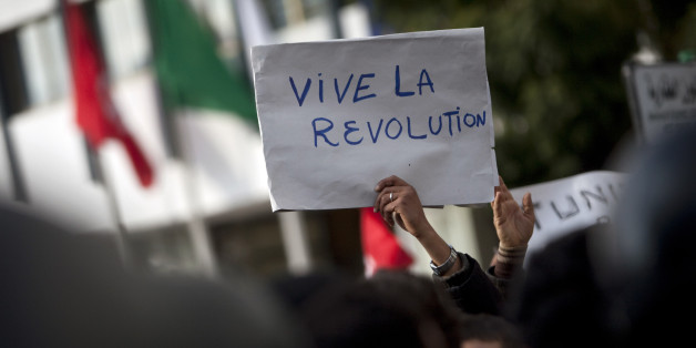 "A board reading ""Long live revolution"" is seen during a demonstration against the Constitutional Democratic Rally (RCD) party of deposed President Zine El Abidine Ben Ali, in the center of Tunis, Wednesday, Jan. 19, 2011. (AP Photo/Thibault Camus)"