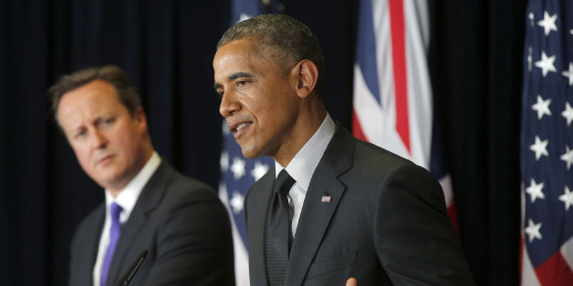 President Barack Obama and British Prime Minister David Cameron participate in a news conference at the G7 summit in Brussels, Belgium, Thursday, June 5, 2014. (AP Photo/Charles Dharapak)