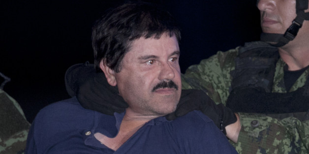 "Joaquin ""El Chapo"" Guzman is made to face the press as he is escorted to a helicopter in handcuffs by Mexican soldiers and marines at a federal hangar in Mexico City, Mexico, Friday, Jan. 8, 2016. Mexican President Enrique Pena Nieto announced that Guzman had been recaptured six months after escaping from a maximum security prison. (AP Photo/Marco Ugarter)"