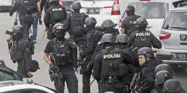 In this Thursday, Jan. 14, 2016, file photo, police officers are deployed near the site of an explosion in Jakarta, Indonesia. Counterterrorism forces apparently did not anticipate Thursday's attack, though authorities announced last month that they knew of a credible threat. Security personnel, however, were able to respond rapidly. That was partly luck _ police happened to be in the area on other business _ but it still bolstered the image of security forces and government. (AP Photo/Dita