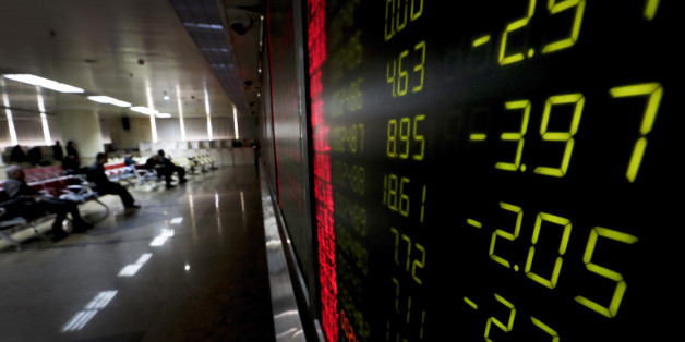 An electronic board display stock prices at a brokerage house in Beijing, Thursday, Jan. 14, 2016. Asian stock markets sank across the board Thursday as pessimistic sentiment following sustained weakness in oil prices and a dive on Wall Street prevailed over data showing economies on the mend. (AP Photo/Andy Wong)