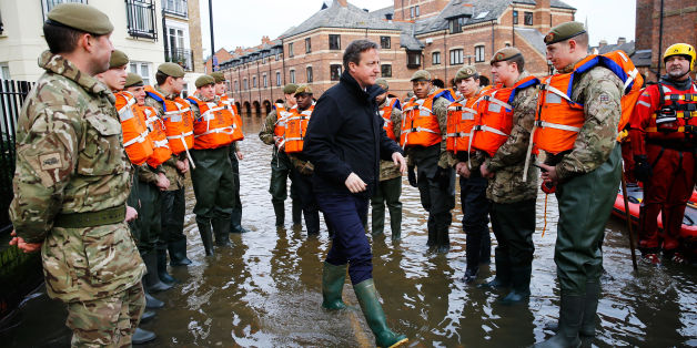 David Cameron meets soldiers working on flood relief in York city centre after the river Ouse burst its banks in December
