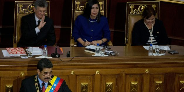 Venezuela's President Nicolas Maduro, bottom left, points to a opposition lawmaker during his annual state of the nation report in Caracas, Venezuela, Friday, Jan. 15, 2016. Above left to right, Henry Ramos Allup, President Of the National Assembly, Gladys Gutierrez , President of the Supreme Court and Tibisay Lucena the President of national Electoral Council.  Ahead of a surprise dire economic data release, Maduro said he would declare an economic emergency giving him 60 days to unilaterally e