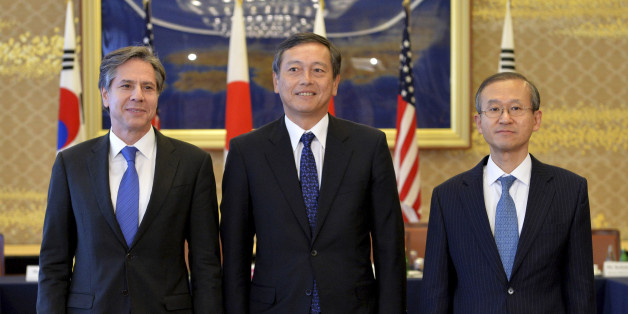 From left, U.S. Deputy Secretary of State Antony Blinken, Japanese Vice Foreign Minister Akitaka Saiki and South Korean First Vice Foreign Minister Lim Sung-nam pose prior to their talks in Tokyo Saturday, Jan. 16, 2016. The trilateral subcabinet-level meeting was held following North Korea's H-bomb claim. (Kazuhiro Nogi/Pool Photo via AP)