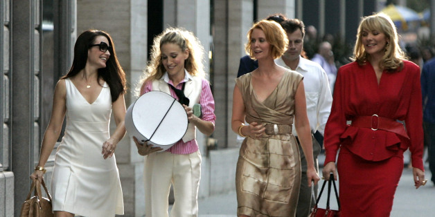 NEW YORK - SEPTEMBER 21:  Actresses Kristin Davis as 'Charlotte,' Sarah Jessica Parker as 'Carrie Bradshaw,' Cynthia Nixon as 'Miranda,' and Kim Cattrall as 'Samantha' on location for 'Sex and the City: The Movie' on September 21, 2007, in New York City.  (Photo by Brian Ach/WireImage)