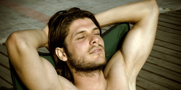 Attractive male is sunbathing