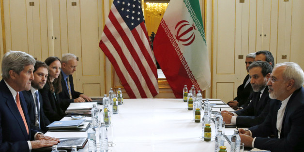 """U.S. Secretary of State John Kerry, left, meets with Iranian Foreign Minister Mohammad Javad Zarif, right, in Vienna, Austria, Saturday, Jan. 16, 2016, on what is expected to be """"implementation day,"""" the day the International Atomic Energy Agency (IAEA) verifies that Iran has met all conditions under the nuclear deal.  (Kevin Lamarque/Pool Photo via AP)"""