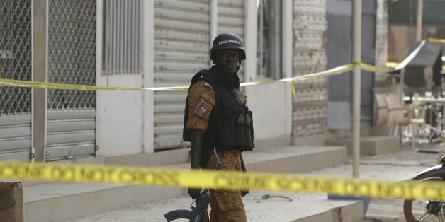 A soldier stand guards outside the Splendid Hotel in Ouagadougou, Burkina Faso, Saturday, Jan. 16, 2016. The overnight seizure of a luxury hotel in Burkina Faso's capital by al-Qaida-linked extremists ended Saturday when Burkina Faso and French security forces killed four jihadist attackers and freed more than 126 people, the West African nation's president said. (AP Photo/Sunday Alamba)