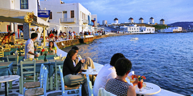 Tourists relaxing at Mykonos