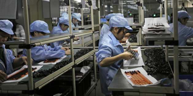 In this Aug. 21, 2015 photo, Chinese women work at Rapoo Technology factory in southern Chinese industrial boomtown of Shenzhen. Factories in China are rapidly replacing those workers with automation, a pivot that's encouraged by rising wages and new official directives aimed at helping the country move away from low-cost manufacturing as the supply of young, pliant workers shrinks. (AP Photo/Vincent Yu)