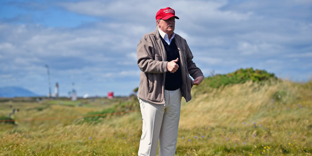 Republican Presidential Candidate Donald Trump drives a golf buggy during his visits to his Scottish golf course Turnberry in July
