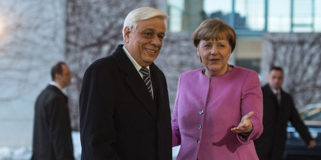 German Chancellor Angela Merkel (R) greets Greek President Prokopis Pavlopoulos prior to talks at the chancellery in in Berlin on January 18, 2016. / AFP / John MACDOUGALL        (Photo credit should read JOHN MACDOUGALL/AFP/Getty Images)