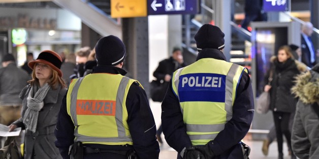 Police patrol in the main train station in Cologne, Germany, Monday, Jan. 18, 2016. Authorities in Germany have arrested a 26-year-old Algerian man on suspicion of committing a sexual assault in Cologne during New Year's celebrations. (AP Photo/Martin Meissner)