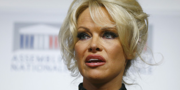 Pamela Anderson, actress and animals rights defender, delivers her speech during a news conference at the French National Assembly to protest the force-feeding of geese used in the production of foie gras, in Paris, France, Tuesday, Jan. 19, 2016. (AP Photo/Francois Mori)